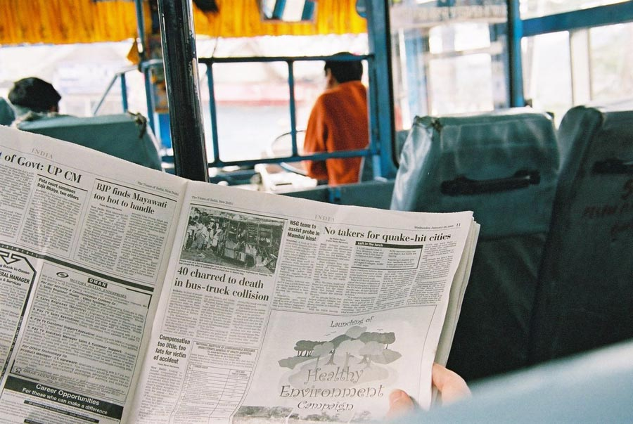 Indian newspaper on an Indian bus