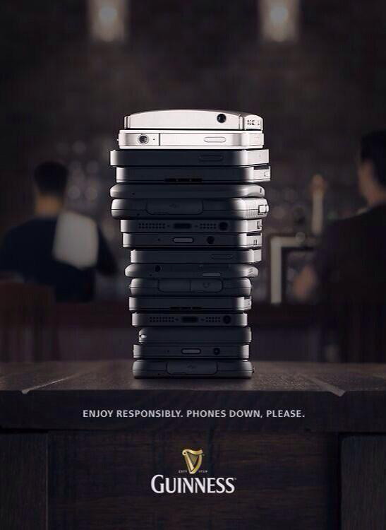 guinness advert - stack of smartphones in shape of guinness glass