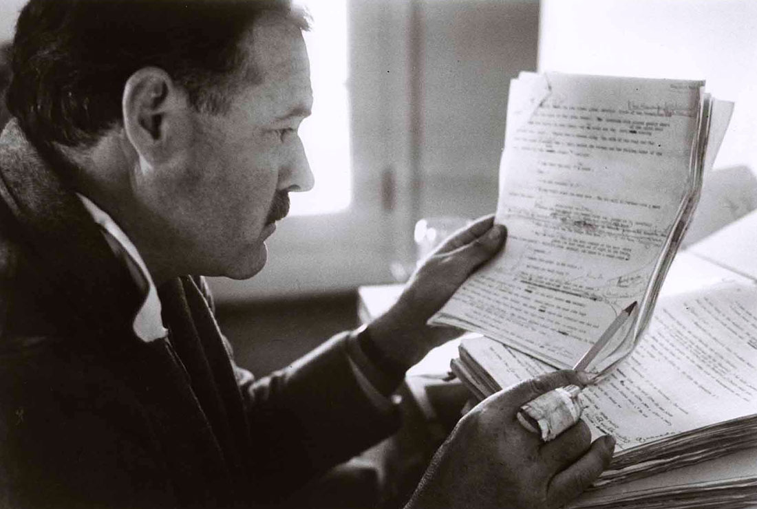 Ernest Hemingway editing his writing with a pencil