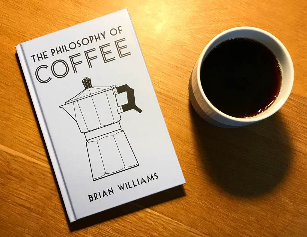The Philosophy Of Coffee by Brian Williams plus cup of coffee